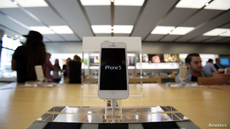 An iPhone 5 is pictured on display at an Apple Store in Pasadena, California, July 22, 2013.