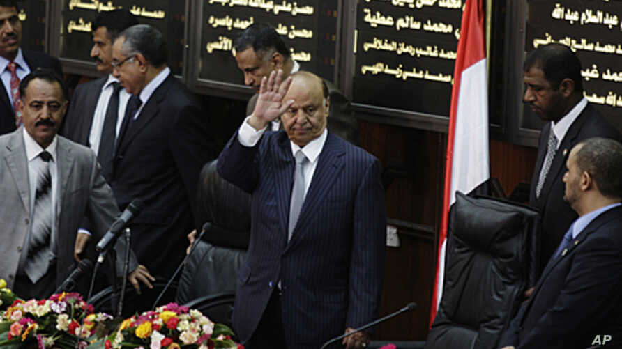 Yemen's newly elected President Abd-Rabbu Mansour Hadi waves as he arrives to the Parliament in Sana'a, Yemen, February 25, 2012.
