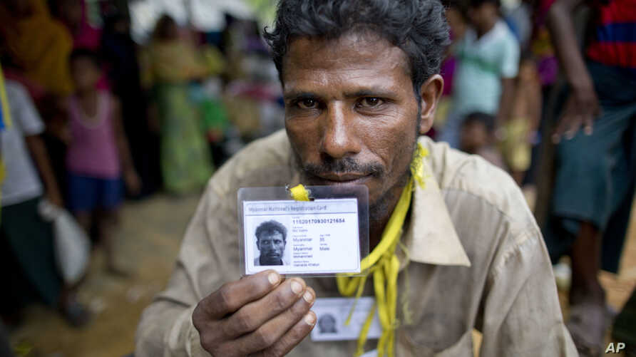 Mohammad Saleem, a Rohingiya man who crossed over to Bangladesh from Myanmar on Sept. 26, 2017, displays an identity card he was issued by the Bangladesh authorities at Kutupalong, Bangladesh, Oct. 1, 2017.