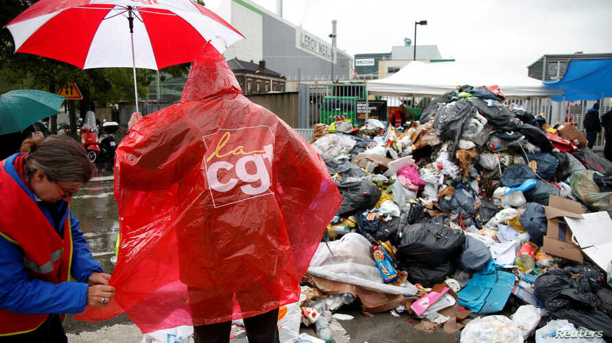 Striking French CGT labor union garbage collectors and sewer workers block access to a waste treatment plant to protest proposed labor reforms, in Ivry-sur-Seine, near Paris,  France, May 31, 2016.
