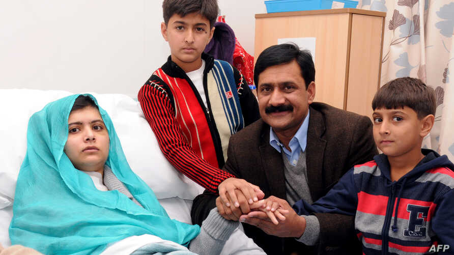 A handout picture received from the Queen Elizabeth Hospital/University Hospitals in Birmingham on October 26, 2012, shows Pakistani schoolgirl Malala Yousafzai, and her family.