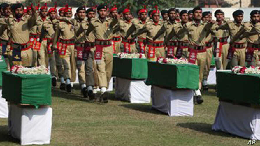 Caskets of Pakistani soldiers killed in the NATO air strike are honored in ceremony.