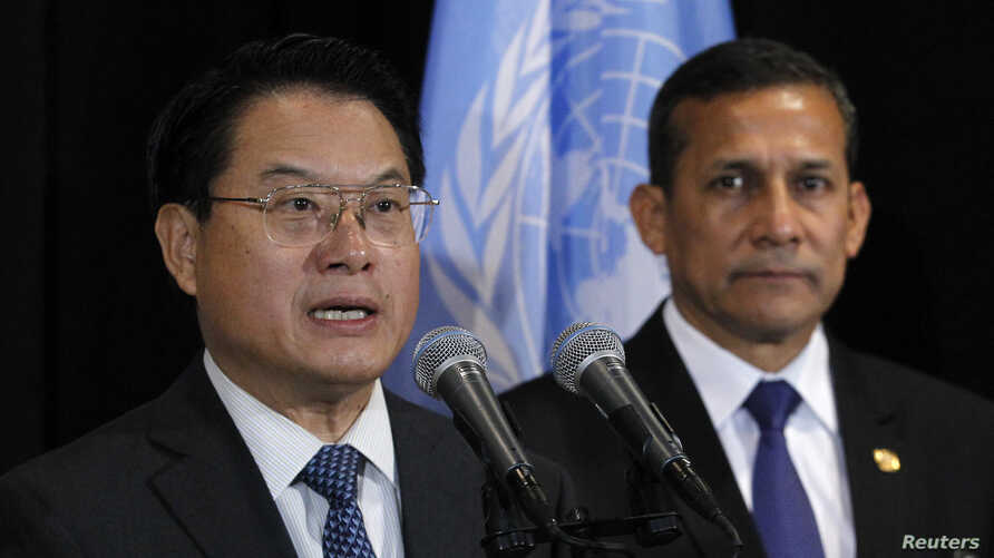 FILE - Director General of the United Nations Industrial Development Organization (UNIDO) Li Yong (L) speaks to the media while Peruvian President Ollanta Humala listens, following a meeting at the United Nations headquarters in New York, Sept. 23, 2