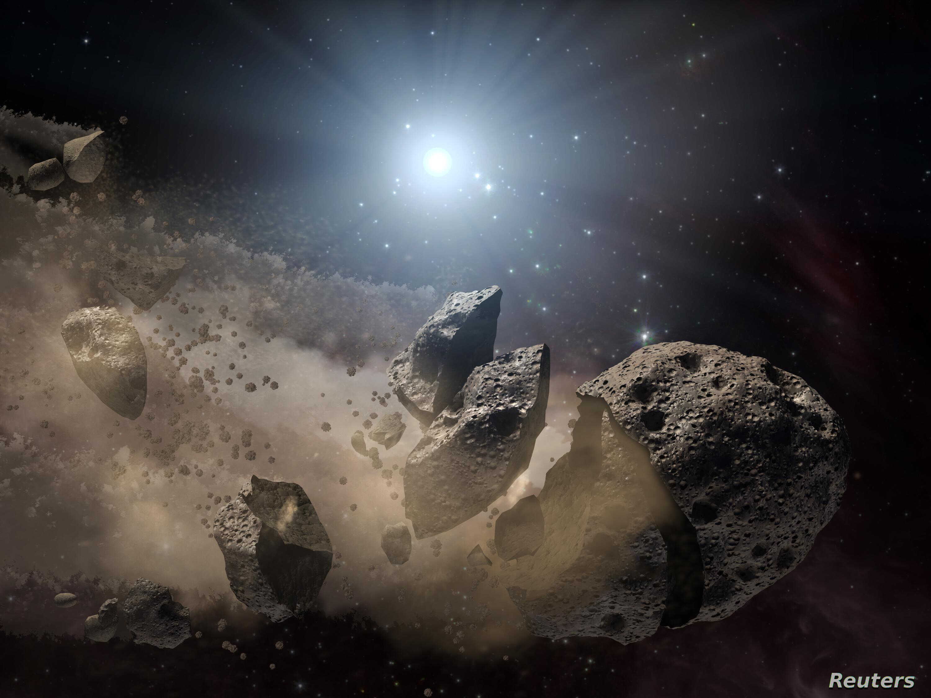 Image courtesy of NASA shows an artist's concept of a broken-up asteroid. Scientists think that a giant asteroid, which broke up long ago in the main asteroid belt between Mars and Jupiter, eventually made its way to Earth and led to the extinction o