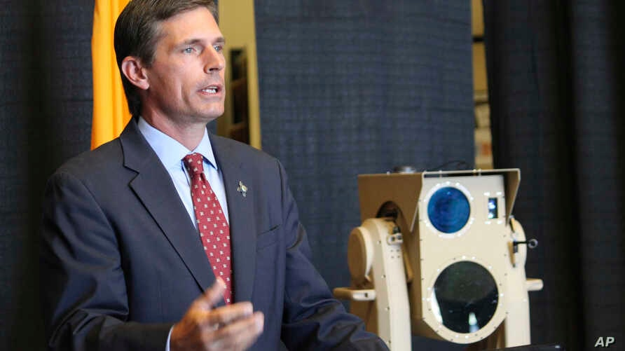 U.S. Sen. Martin Heinrich, D-N.M., discusses the potential of high-energy laser weapons systems being developed by engineers at Boeing during a news conference in Albuquerque, N.M., Aug. 23, 2017.