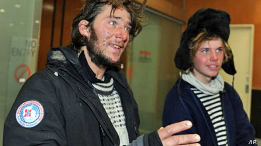 Norwegian adventurers Jarle Andhoy (L) and Samuel Massie (R) said they held slim hopes of finding the three other members of their party alive after their yacht went missing in a fierce Antarctic storm, Feb. 28, 2011