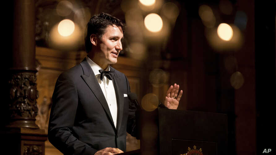 FILE - Canadian Prime Minister Justin Trudeau speaks in Hamburg, Germany, Feb. 17, 2017. Trudeau and Ivanka Trump attending a Broadway musical about how Canada helped thousands stranded after September 11.