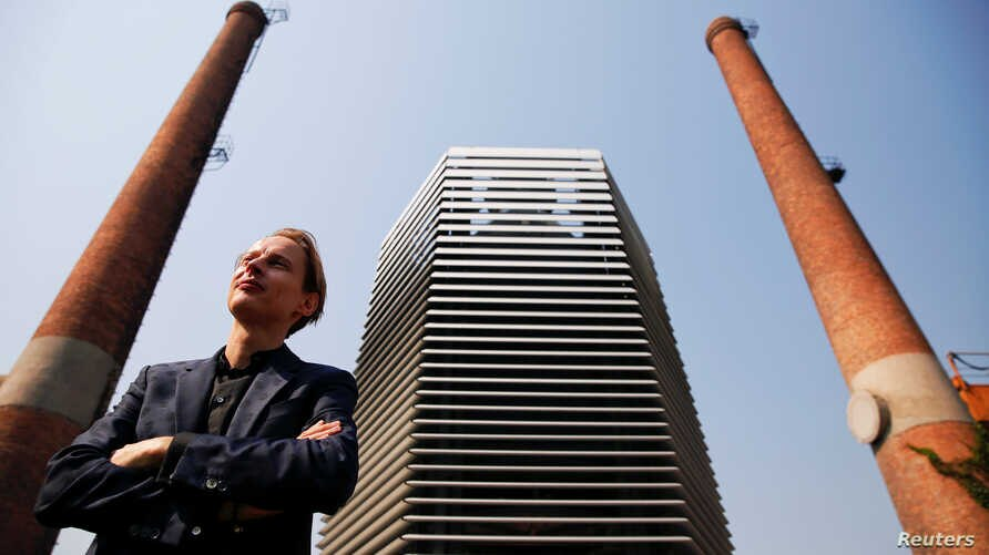 Dutch artist and innovator Daan Roosegaarde poses in front of the Smog Free Tower, the world's largest smog vacuum cleaner as he presents his The Smog Free Project at D-751 art zone in Beijing, September 29, 2016.