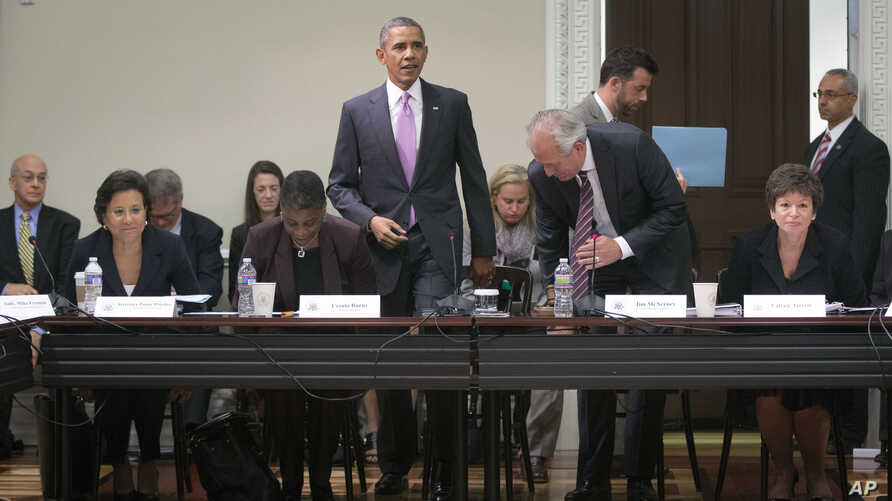 President Barack Obama, center, takes his seat before speaking to members of his Export Council during their meeting in the Eisenhower Executive Office Building on the White House complex, Sept. 19, 2013, in Washington.