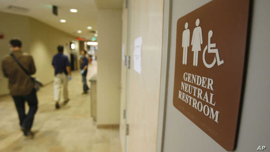 A sign marks the entrance to a gender neutral restroom at the University of Vermont in Burlington, Vt. For opponents of transgender rights, a favorite line of attack is to oppose policies that would allow people to choose whether to use a men's or wo