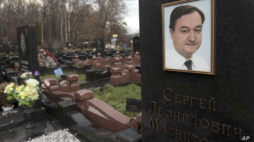 A tombstone on the grave of lawyer Sergei Magnitsky who died in jail, at a cemetery in Moscow, Nov. 16, 2012.