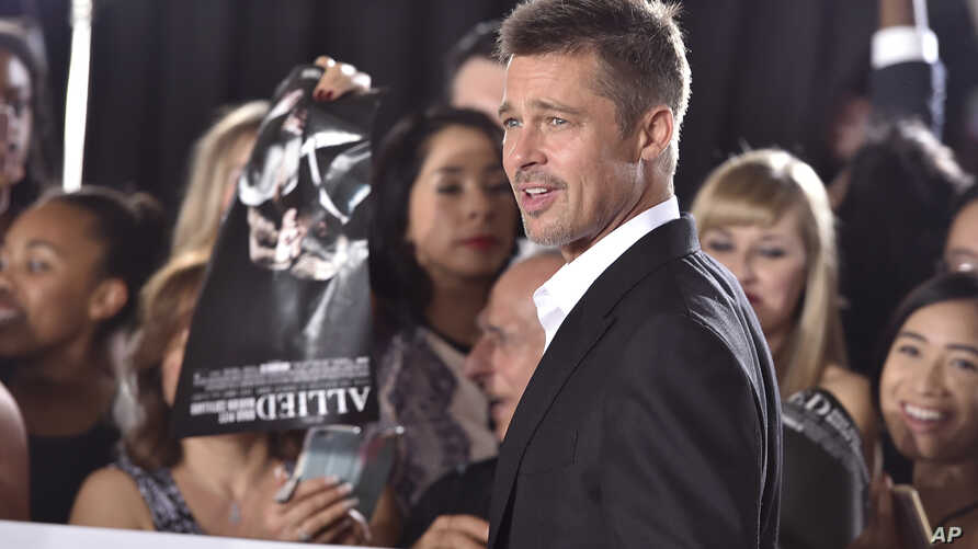 """Brad Pitt arrives at the Los Angeles premiere of """"Allied"""" at the Regency Village Theater on Nov. 9, 2016."""