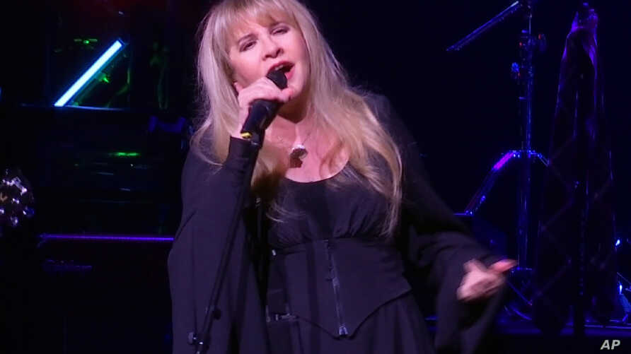"""This image made from video shows singer Stevie Nicks singing """"Rhiannon"""" during a surprise performance after the curtain call for the musical  """"School of Rock,"""" April 26, 2016, in New York."""