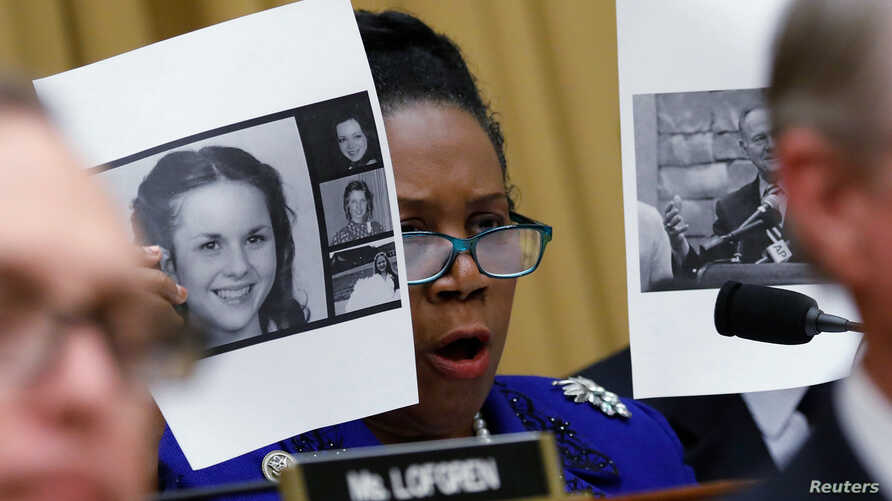 Rep. Sheila Jackson Lee (D-TX) holds up pictures of women who've accused U.S. Senate candidate Roy Moore of sexual misconduct, while questioning U.S. Attorney General Jeff Sessions (Not Pictured) during  the House Judiciary Committee oversight hearin...