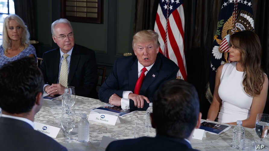President Donald Trump speaks during a briefing on the opioid crisis, Aug. 8, 2017, at Trump National Golf Club in Bedminster, N.J. From left are, White House senior adviser Kellyanne Conway, Health and Human Services Secretary Tom Price, Trump, and ...