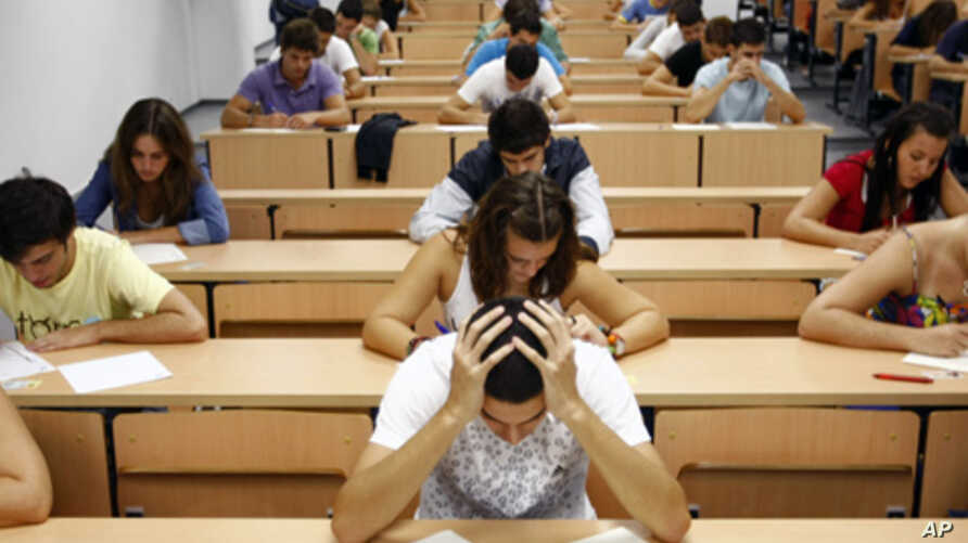 Students take a university entrance examination at a lecture hall in the Andalusian capital of Seville, southern Spain. Researchers created a technique involving having test-takers write down their fears – in turn dramatically improving their test sc