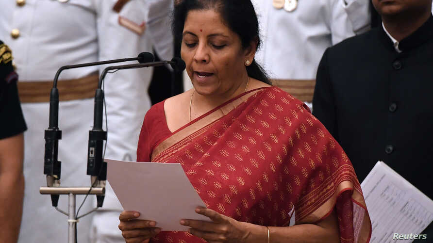 India's ruling Bharatiya Janata Party (BJP) politician and member of parliament Nirmala Sitharaman takes the oath during the swearing-in ceremony of new ministers at the Presidential Palace in New Delhi, Sept. 3, 2017.