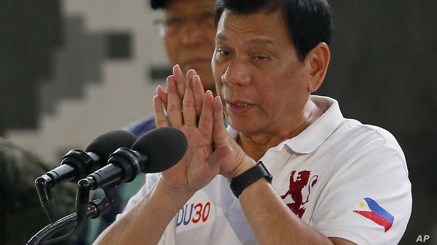 Philippine President Rodrigo Duterte gestures while addressing the Philippine Army Scout Rangers during his visit to their headquarters at Camp Tecson in San Miguel township, north of Manila, Philippines, Sept. 15, 2016.