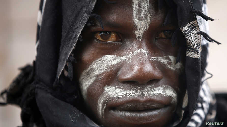FILE - A member of the anti-balaka, a Christian militia, is pictured in the village of Zawa, Central African Republic.