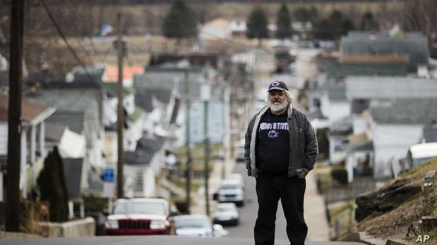 Ed Harry, a retired union leader and lifelong Democrat who voted for Donald Trump, poses for a photo in Plymouth, Pennsylvania, Jan. 5, 2017.