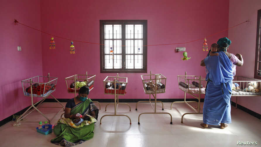 FILE - Nurses tend to newborn baby girls at the Life Line Trust orphanage in Salem in the southern Indian state of Tamil Nadu, June 20, 2013.