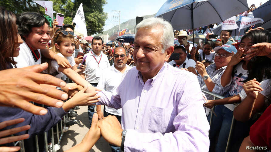 Leftist front-runner Andres Manuel Lopez Obrador of the National Regeneration Movement (MORENA) is greeted by supporters after a campaign rally in Tlapa de Comonfort, in Guerrero state, Mexico, June 7, 2018.
