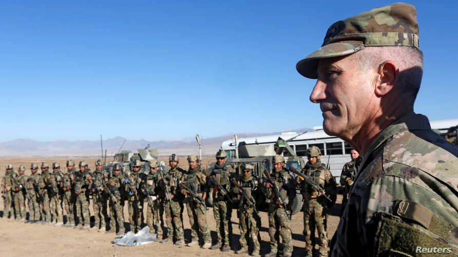 FILE - U.S. Army General John Nicholson, commander of Resolute Support forces and U.S. forces in Afghanistan, speaks with Afghan police special forces after they took part in a military exercise in Logar province, Afghanistan, Nov. 30, 2017.