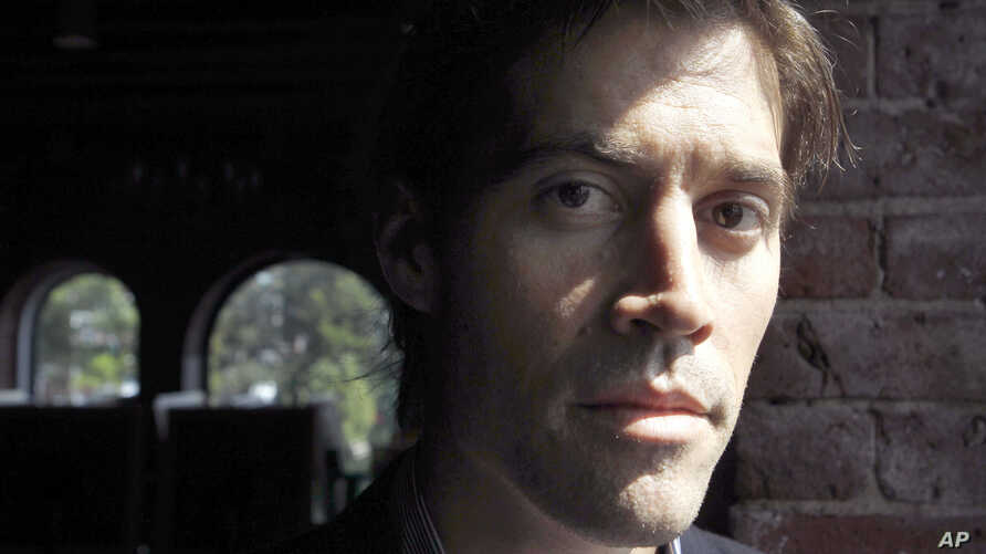 FILE - James Foley, pictured in May 2011, was one of 61 journalists killed last year, according to data from the Committee to Protect Jourmalists.