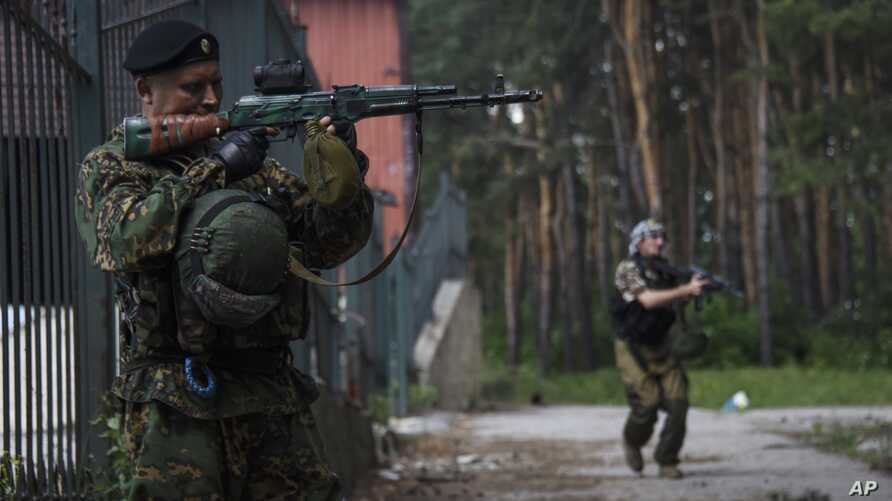 Russian-backed rebels guard their position near Marinka in the suburbs of Donetsk, eastern Ukraine, Thursday, June 4, 2015.