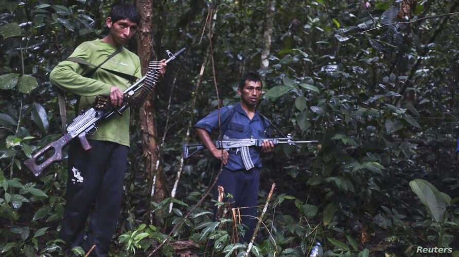 Members of Peru's Shining Path terrorist group, speak to journalists in a remote jungle region in southern Peru, Cuzco, April 17, 2012.