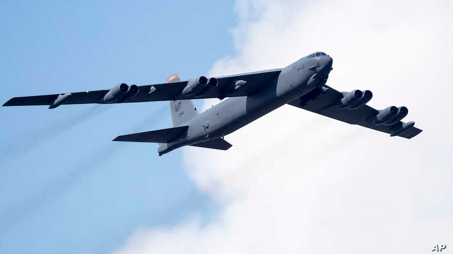 FILE - A U.S. Air Force B-52 strategic bomber flies over Pabrade during a military exercise  some 60 km (38 miles) north of the capital Vilnius, Lithuania, June 16, 2016.