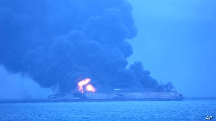 """In this photo provided by Korea Coast Guard, the Panama-registered tanker """"Sanchi"""" is seen ablaze after a collision with a Hong Kong-registered freighter off China's eastern coast, Jan. 7, 2018."""