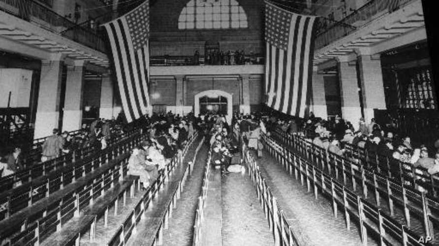 This is a 1924 photo of the registry room at Ellis Island in New York harbor. New York and New Jersey are involved in a dispute over which state has jurisdiction over the national landmark, which was a gateway to America for millions of immigrants.(A
