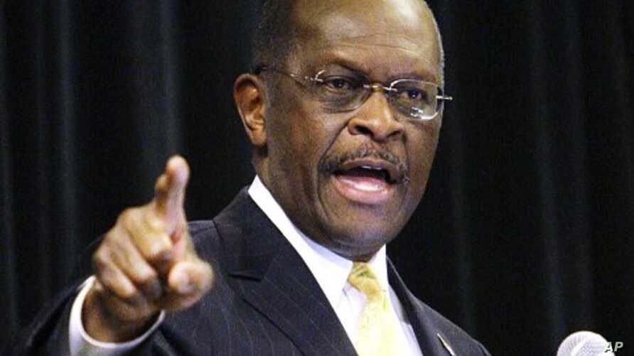 Republican presidential candidate, Herman Cain makes a point during a speech at a campaign rally, in Dayton, Ohio, November 30, 2011.