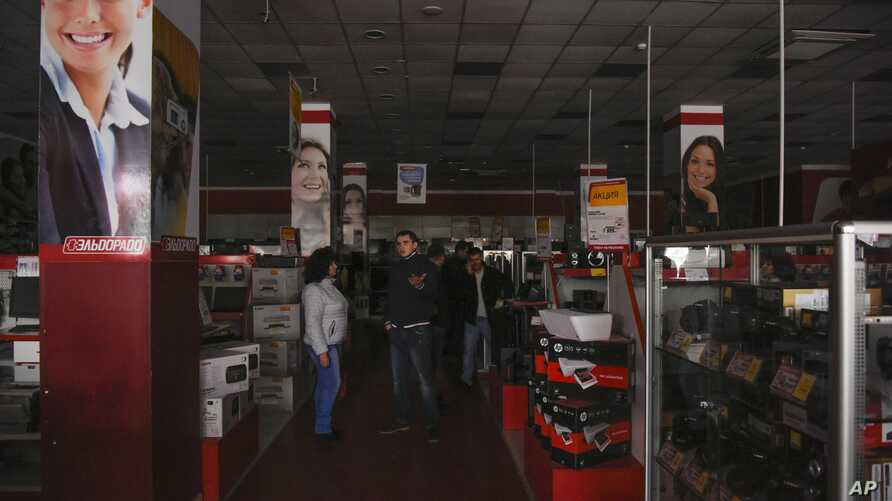 Customers are seen standing in an electronics store after a power failure, in Simferopol, Crimea, Nov. 22, 2015.