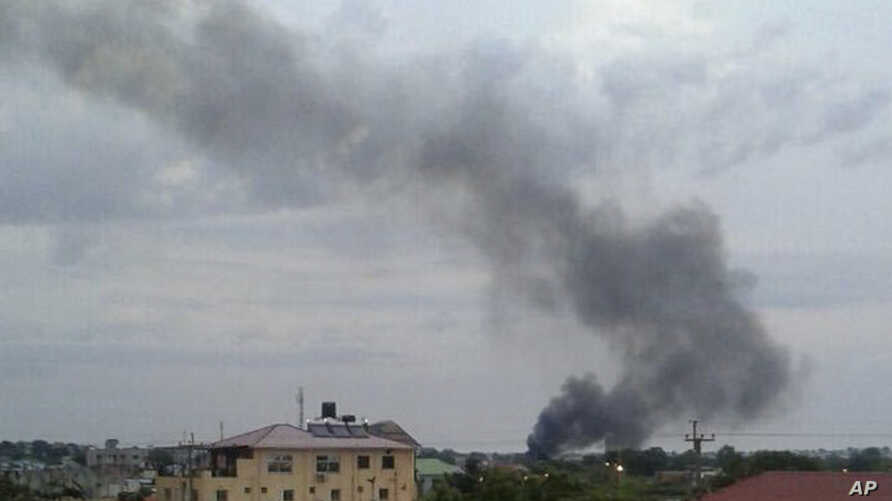 In this photo taken Sunday, July 10, 2016, black smoke is seen rising above the capital Juba, in South Sudan.