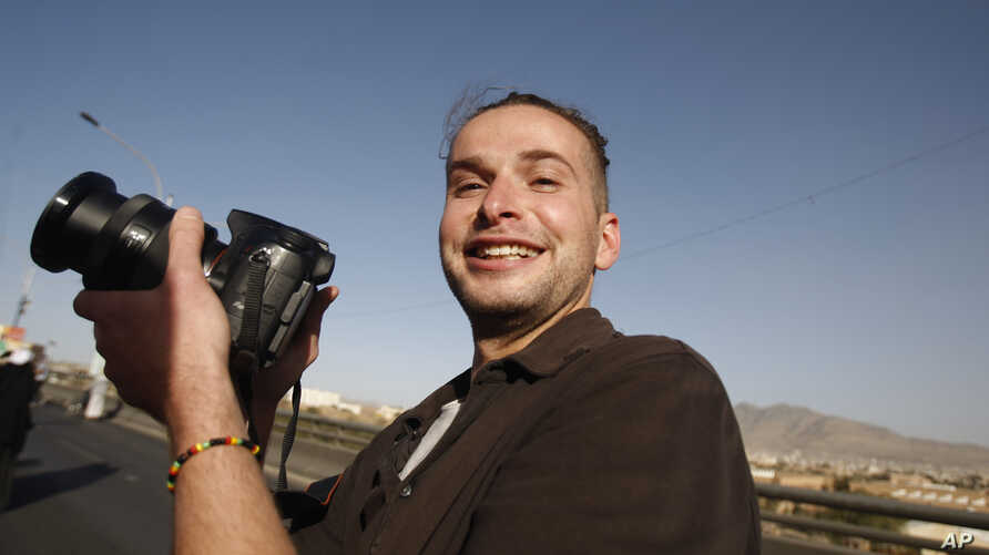 FILE -Luke Somers, 33, an American photojournalist who was kidnapped over a year ago by al-Qaida, poses for a picture during a parade marking the second anniversary of the revolution in Sanaa, Yemen,Feb. 11, 2013.