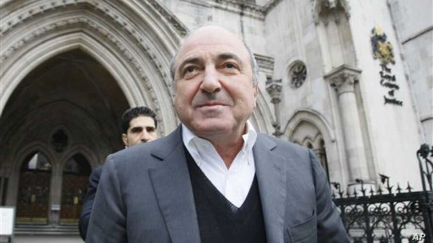 Self-exiled oligarch Boris Berezovsky leaves the High Court in London after winning his libel case against a Russian broadcaster that accused him of masterminding the murder of a former Russian agent in London. (AP Photo/Alastair Grant, File)