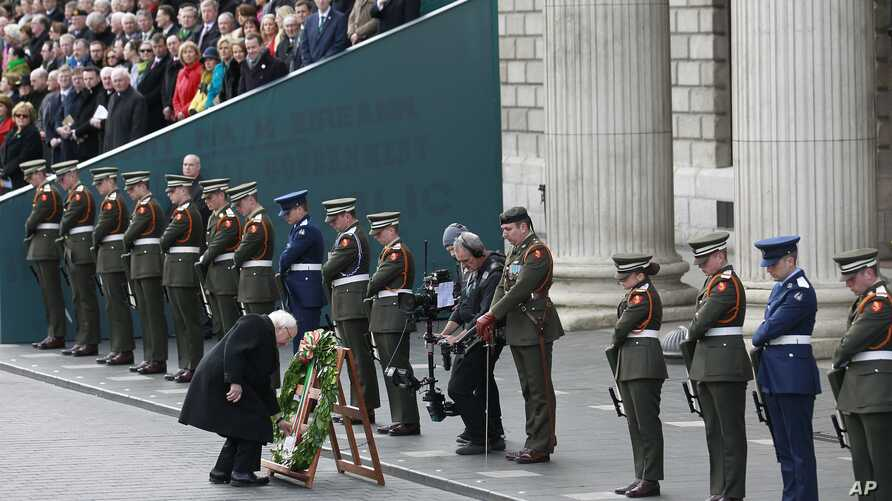 Irish President Michael D Higgins lays a wreath at the General Post Office on O'Connell street, Dublin, Ireland, March 27, 2016.
