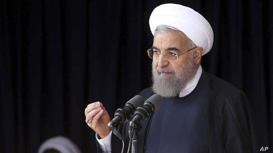 In this photo released by official website of the office of the Iranian Presidency, President Hassan Rouhani speaks to a crowd during a visit to the central city of Arak, Iran, Oct. 23, 2016.