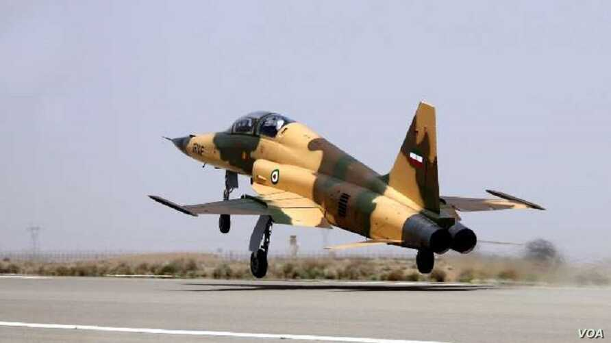 Iran's Kowsar fighter jet, which it says is domestically designed, takes off as part of its unveiling to the world, Aug. 21, 2018.