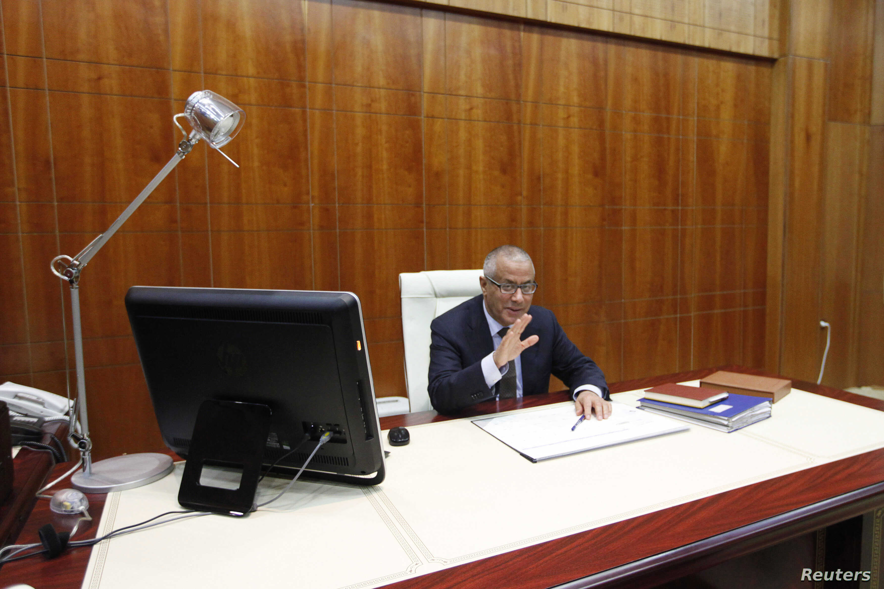 Libya's Prime Minister Ali Zeidan speaks during an interview with Reuters in Tripoli, March 10, 2014.