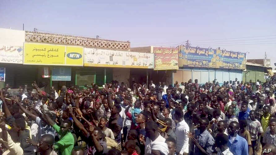 FILE - In this Dec. 25, 2018 handout image provided a Sudanese activist, people chant slogans during a demonstration in Kordofan, Sudan.
