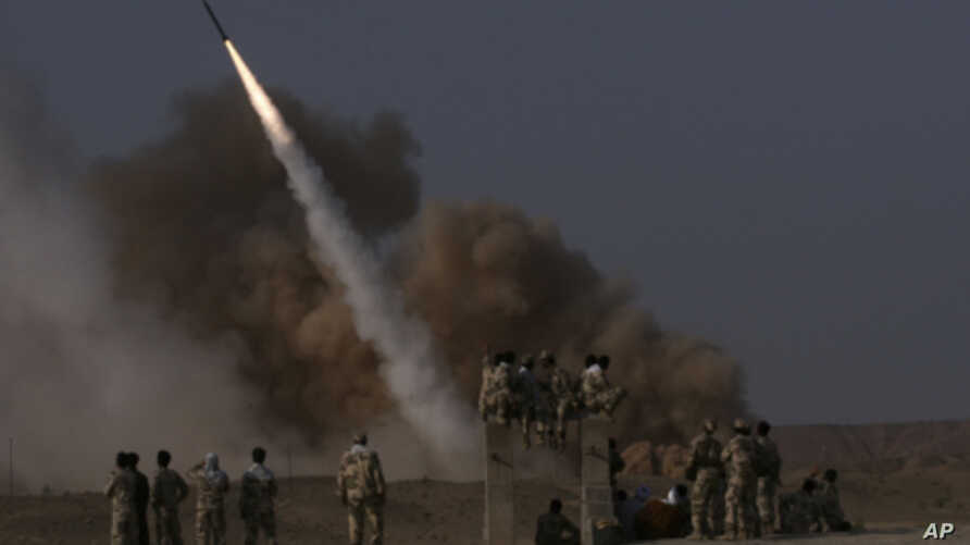 Members of Iran's revolutionary guard launch a surface to surface missile during exercises near the city of Qom in June, 2011 (file photo).