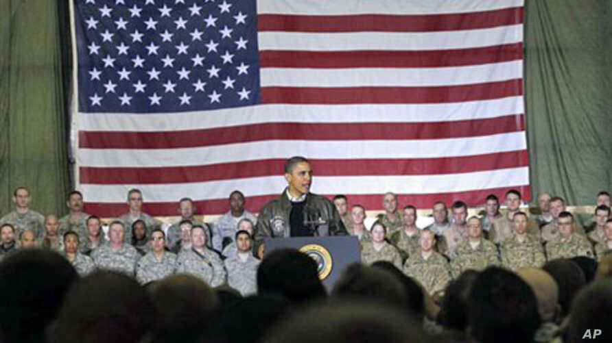 President Barack Obama speaks to troops at a rally during an unannounced visit at Bagram Air Field in Afghanistan, Dec 03, 2010 (file photo)