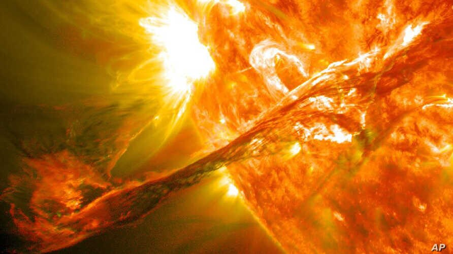 A NASA image captured by NASA's Solar Dynamics Observatory shows a blast of plasma streaming from the sun in August 2012.
