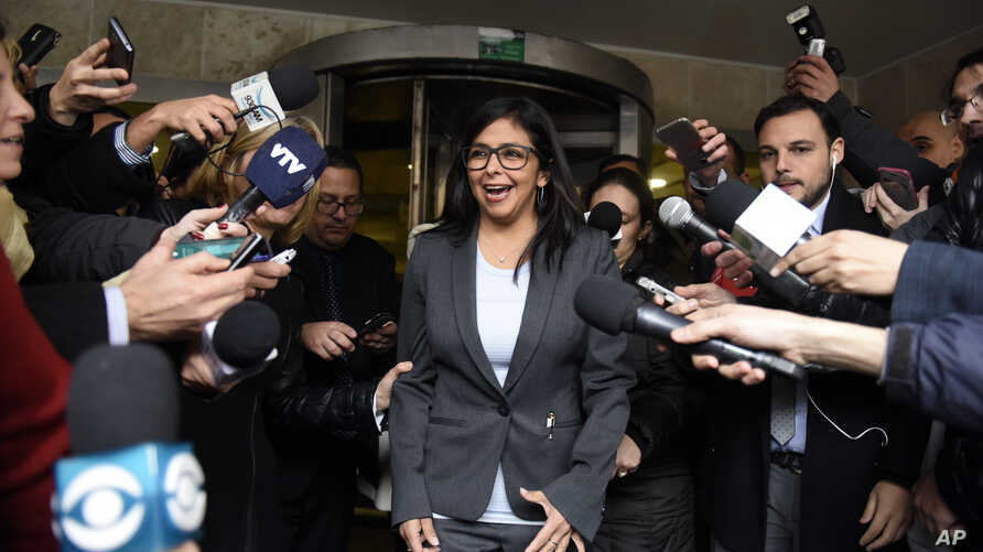 FILE - Venezuela's Delcy Rodriguez speaks to reporters as she leaves a meeting with fellow foreign ministers to discuss the transition of the presidency of Mercosur in Montevideo, Uruguay, July 11, 2016. The founding members of Mercosur are giving Ve