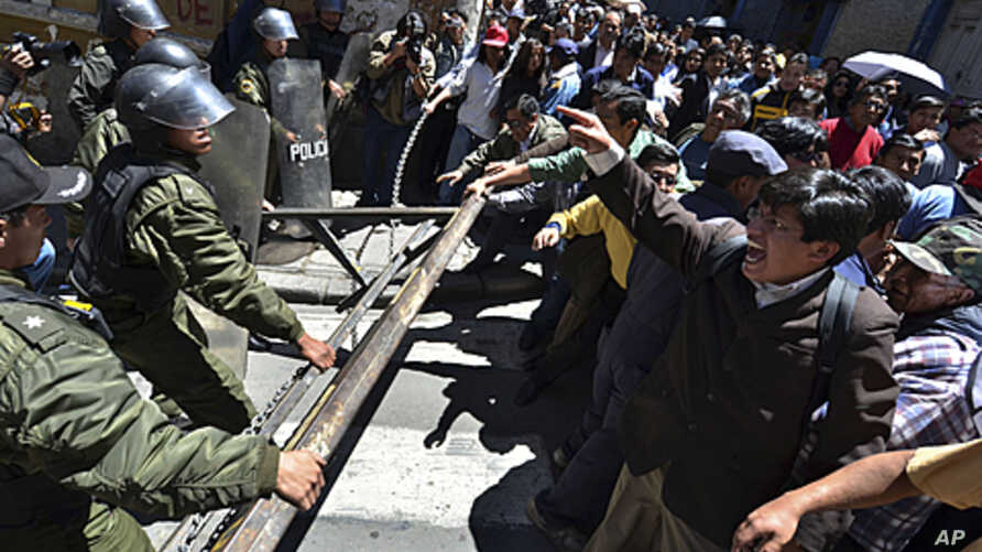 Protesters clash with police officers during a march in La Paz, Bolivia. Bolivia's Defense Minister Cecilia Chacon resigned Monday after police violently broke up Sunday a protest by indigenous and environmentalists groups who were marching towards L