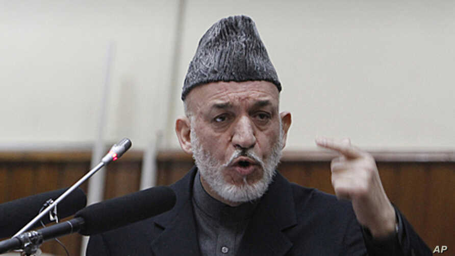 Afghan President Hamid Karzai, right, delivers a speech at the opening of the second year of the Afghanistan parliament in Kabul, Afghanistan, January 21, 2012.