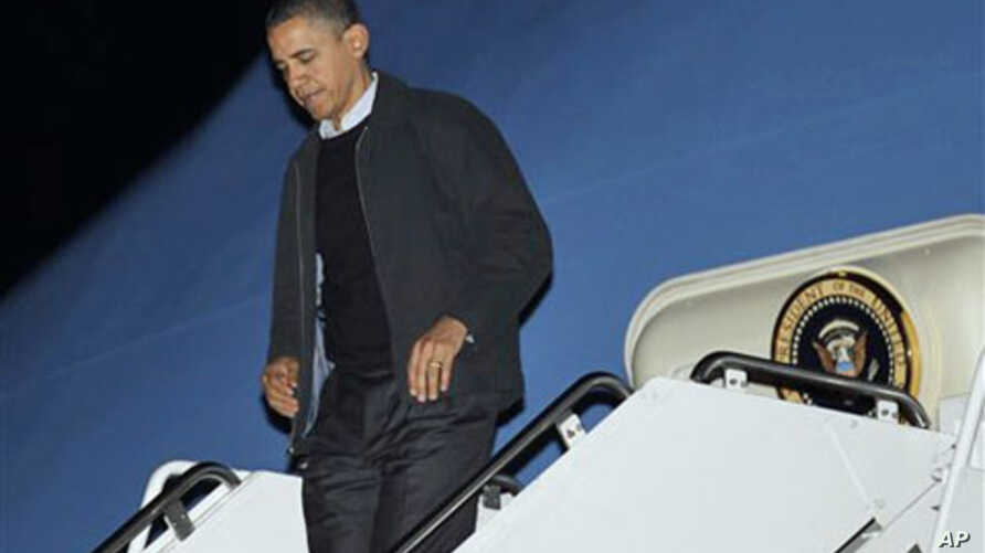 President Barack Obama steps off Air Force One, 04 Dec 2010, after his arrival at Andrews Air Force Base. Obama was returning from an unannounced trip to Afghanistan